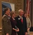 Sue Devine receiving award