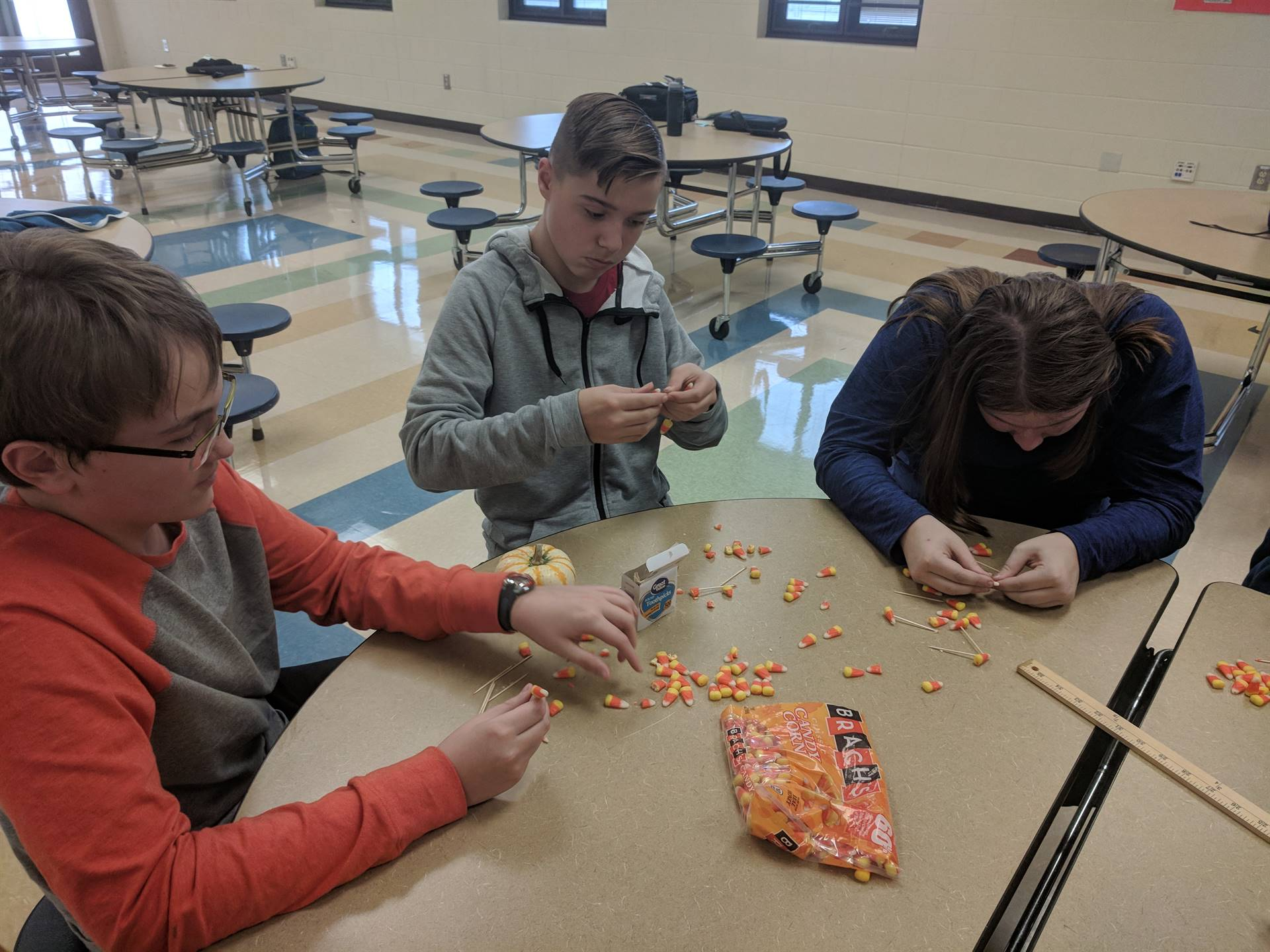 Jacob, Hunter and Elaine find it harder than imagined to put toothpicks in candy corn
