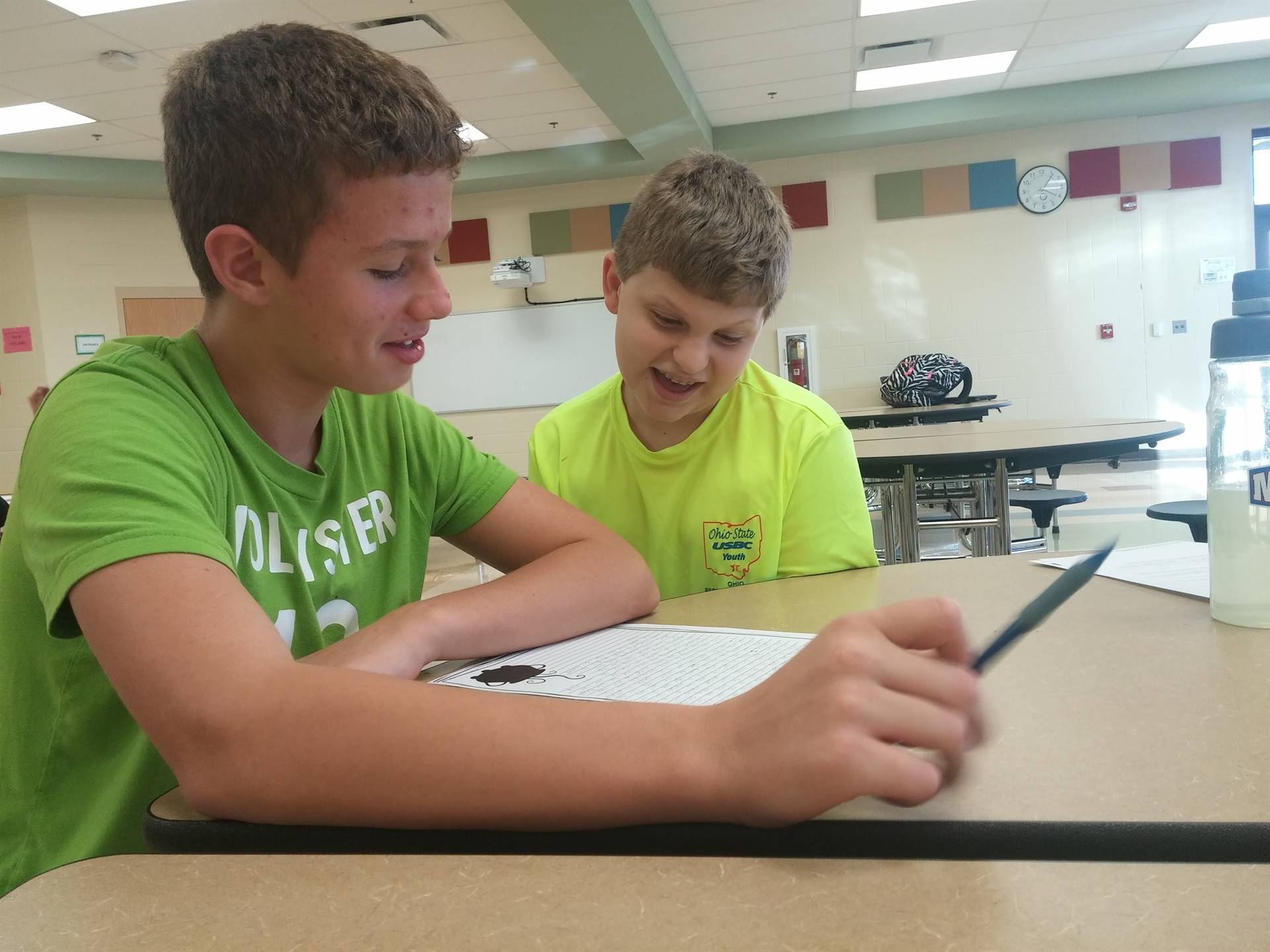 Joel and Cole helping each other with homework
